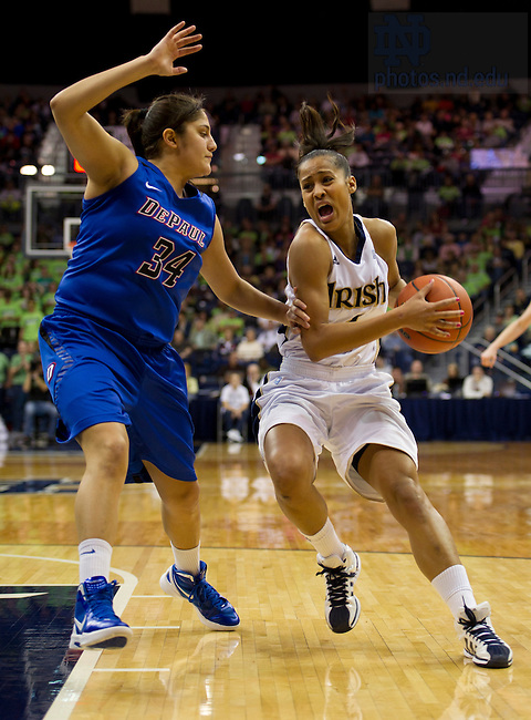 February 5, 2012; Skylar Diggins drives to the net past DePaul guard Deanna Ortiz during the second half. Notre Dame won 90-70. Photo by Barbara Johnston/University of Notre Dame