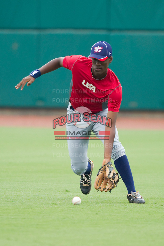 Right fielder Brian Ragira #18 fields a ground ball during the USA Baseball 18U National Team Trials at the USA Baseball National Training Center on June 30, 2010, in Cary, North Carolina.  Photo by Brian Westerholt / Four Seam Images