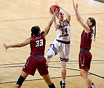 SIOUX FALLS, SD: MARCH 7: Taylor Higginbotham #24 from Western Illinois shoots between Mikale Rogers #33 and Jenna Gunn #32 from IUPUI during the Women's Summit League Basketball Championship Game on March 7, 2017 at the Denny Sanford Premier Center in Sioux Falls, SD. (Photo by Dave Eggen/Inertia)