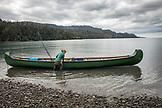 USA, Alaska, Homer, China Poot Bay, Kachemak Bay, departing the rock beach near the Kachemak Bay Wilderness Lodge by canoe