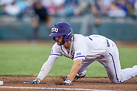 TCU Horned Frogs first baseman Jeremie Fagnan (32) dives back to first base during the NCAA College baseball World Series against the Vanderbilt Commodores on June 16, 2015 at TD Ameritrade Park in Omaha, Nebraska. Vanderbilt defeated TCU 1-0. (Andrew Woolley/Four Seam Images)