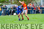 Eoghan McCrohan for Renard being pushed further toward the wing by Valentia's Colm Casey.