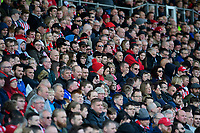 Lincoln City fans watch their team in action<br /> <br /> Photographer Chris Vaughan/CameraSport<br /> <br /> The EFL Sky Bet League Two - Lincoln City v Cheltenham Town - Saturday 13th April 2019 - Sincil Bank - Lincoln<br /> <br /> World Copyright © 2019 CameraSport. All rights reserved. 43 Linden Ave. Countesthorpe. Leicester. England. LE8 5PG - Tel: +44 (0) 116 277 4147 - admin@camerasport.com - www.camerasport.com