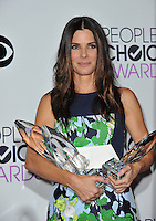 Sandra Bullock in the pressroom at the 2014 People's Choice Awards at the Nokia Theatre, LA Live.<br /> January 8, 2014  Los Angeles, CA<br /> Picture: Paul Smith / Featureflash