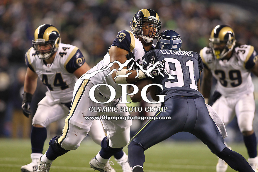 January 02, 2011:  Seattle Seahawks defensive end #91 Chris Clemons gets blocked out by St. Louis Rams tackle #76 Roger Staffold at Quest Field in Seattle, WA.  Seattle won 16-6 over St. Louis.