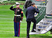 Washington, D.C. - March 25, 2010 -- United States President Barack Obama salutes the Marine Guard as he boards Marine 1 on the South Lawn of the White House to depart for Iowa City, Iowa where he will deliver remarks on the benefits of his health care reform bill which was signed earlier in the week on Thursday, March 25, 2010..Credit: Ron Sachs / Pool via CNP