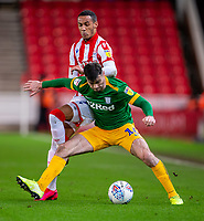 12th February 2020; Bet365 Stadium, Stoke, Staffordshire, England; English Championship Football, Stoke City versus Preston North End; Tom Ince of Stoke City tackles Andrew Hughes of Preston North End