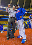 1 April 2016: Toronto Blue Jays baserunning and outfield coach Tim Raines, and former Montreal Expo, poses for a selfie with Montreal broadcaster Elliott Price prior to a pre-season exhibition game between the Blue Jays and the Boston Red Sox at Olympic Stadium in Montreal, Quebec, Canada. The Red Sox defeated the Blue Jays 4-2 in the first of two MLB weekend exhibition games, which saw an attendance of 52,682 at the former home on the Montreal Expos. Mandatory Credit: Ed Wolfstein Photo *** RAW (NEF) Image File Available ***