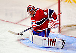 9 January 2010: Montreal Canadiens' goaltender Jaroslav Halak makes a first period save against the New Jersey Devils at the Bell Centre in Montreal, Quebec, Canada. The Devils edged out the Canadiens 2-1 in overtime. Mandatory Credit: Ed Wolfstein Photo