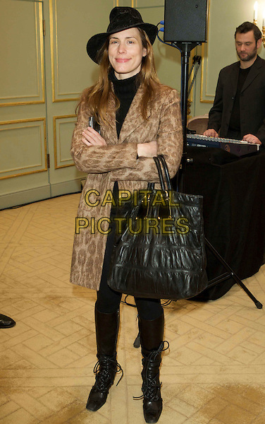 "CELIA VON BISMARCK.Press conference & photo opportunity ahead of the ""Cinema for Peace"" gala held at the Hotel Adlon, alongside the 59th Berlinale Film Festival in Berlin, Germany..February 8th, 2009.full length arms crossed coat brown pattern large oversized bag purse hat.CAP/PPG/JH.©Jens Hartmann/People Picture/Capital Pictures"