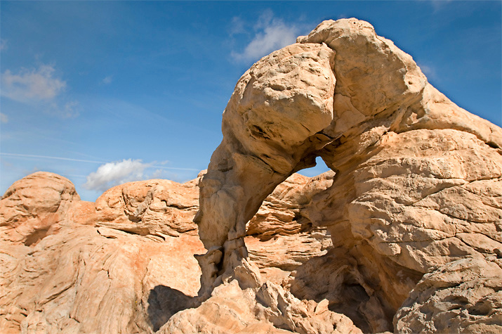 A small arch has formed in the wind eroded sandstone formations on the Paria Plateau, AZ