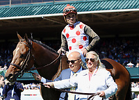 LEXINGTON, KY - April 08, 2017, #9 Awesome Slew and jockey Joel Rosario enter the winner's presentation on the turf course with trainer Graham Motion and owner Charlotte Weber after winning the 31st running of The Commonwealth Grade 3 $250,000 for owner Live Oak PLantation and trainer Mark Casse at Keeneland Race Course.  Lexington, Kentucky. (Photo by Candice Chavez/Eclipse Sportswire/Getty Images)