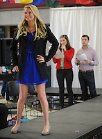 NWA Democrat-Gazette/ANDY SHUPE<br /> Ashlyn Quickel (from left), a University of Arkansas sophomore from Little Rock, models a business-casual outfit Tuesday, Feb. 14, 2017, as Maggie Benton, Associated Student Government Student Body vice president, and Connor Flock, Associated Student Government Student Body president, emcee the event during the &quot;Dress for Success&quot; fashion show hosted by the university's Career Development Center and Associated Student Government at the Arkansas Union on the university campus in Fayetteville. Student models showcased clothing available from Boss Hog Outfitters Career Closet which provides students with free use of professional business attire for career fairs or formal events.