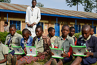 RWANDA, Ruhengeri, Initiative One laptop per child OLPC founded by Nicholas Negroponte, children using a XO laptop at Primary school