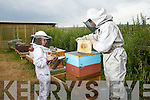 Beekeeper Peter Curran with his daughter Isabelle at his hives near Ardfert.