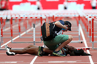 Jasmin Stowers of USA is lies injured on the track after competing in the womenís 100 metres hurdles during the Muller Anniversary Games at The London Stadium on 9th July 2017