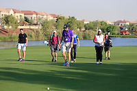 Shane Lowry (IRL) and his team walking up the 18th fairway during the preview for the DP World Tour Championship at the Earth course,  Jumeirah Golf Estates in Dubai, UAE,  18/11/2015.<br /> Picture: Golffile | Thos Caffrey<br /> <br /> All photo usage must carry mandatory copyright credit (© Golffile | Thos Caffrey)