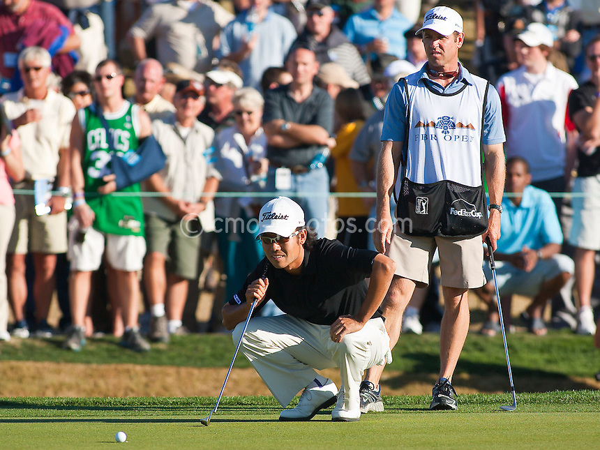 Feb 1, 2009; Scottsdale, AZ, USA; Kevin Na (KOR) lines up a putt on the 18th hole during the final round of the FBR Open at the TPC Scottsdale.  Na would miss the putt and miss a playoff by one stroke.