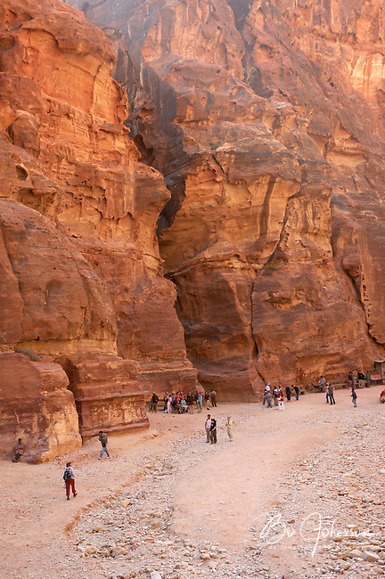 The narrow gorge As-Siq, the 1200 meter long ancient entrance to Petra, as it's ending in front of impressive The Treasury (Al-Khazneh).<br />