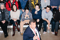 With his wife (second from left) and three of his four kids watching from the front row, Republican presidential candidate and New Jersey governor Chris Christie speaks at his final New Hampshire town hall of the primary election at the St. George Greek Orthodox Cathedral in Manchester, New Hampshire, on Mon., Feb., 8, 2016.