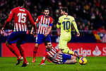 Lucas Hernandez of Atletico de Madrid (C) fights for the ball with Lionel Messi of FC Barcelona (R) during the La Liga 2018-19 match between Atletico Madrid and FC Barcelona at Wanda Metropolitano on November 24 2018 in Madrid, Spain. Photo by Diego Souto / Power Sport Images
