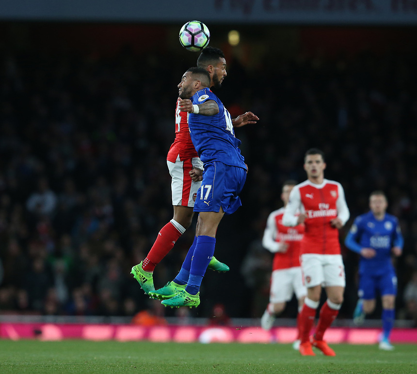 Arsenal's Theo Walcott and Leicester City's Danny Simpson<br /> <br /> Photographer Stephen White/CameraSport<br /> <br /> The Premier League - Arsenal v Leicester City - Wednesday 26th April 2017 - Emirates Stadium - London<br /> <br /> World Copyright &copy; 2017 CameraSport. All rights reserved. 43 Linden Ave. Countesthorpe. Leicester. England. LE8 5PG - Tel: +44 (0) 116 277 4147 - admin@camerasport.com - www.camerasport.com
