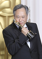 02/24/13 Hollywood, CA: Ang Lee poses in the press room during the 85th Annual Academy Awards.