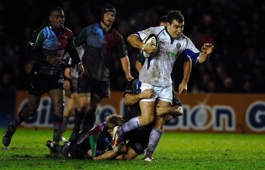 Photo: Richard Lane..NEC Harlequins v Bath Rugby. Guinness Premiership. 06/01/2007. .Bath's Olly Barkley is tackled by Quins' Stuart Abbott and Paul Volley.