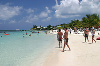 The beach at West Bay on the Bay Island of Roatan can be busy with visitors from around the world.