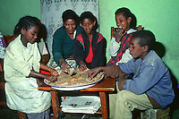 Ethiopian family eating Injera, the national dish made out of teff flour