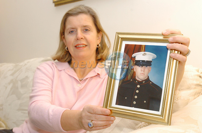 Penny McCotter holding a picture of her son Philip who is recovering in Hospital in the USA after being ambushed in Iraq..Photo Fran Caffrey Newsfile.ie..This Picture has been sent to you by Newsfile Ltd..The Studio,.Millmount Abbey,.Drogheda,.Co. Meath,.Ireland..Tel: +353(0)41-9871240.Fax: +353(0)41-9871260.ISDN: +353(0)41-9871010.www.newsfile.ie..general email: pictures@newsfile.ie
