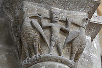 Carved capital depicting the ascension of Alexander the Great, with Alexander holding 2 eagles, from the transept of the Abbatiale Sainte-Foy de Conques or Abbey-church of Saint-Foy, Conques, Aveyron, Midi-Pyrenees, France, a Romanesque abbey church begun 1050 under abbot Odolric to house the remains of St Foy, a 4th century female martyr. The church is on the pilgrimage route to Santiago da Compostela, and is listed as a historic monument and a UNESCO World Heritage Site. Picture by Manuel Cohen