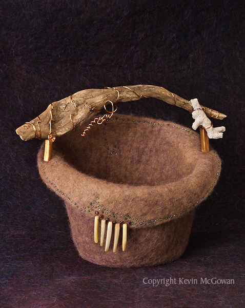 Alpaca wool basket with driftwood handle,   and embellishments of coral, shell, glass beads and copper