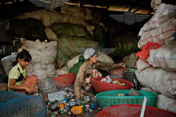 Rubbish collectors work beside a railway yard in Yangon (Rangoon).