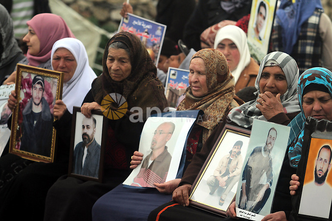 Palestinian women hold portraits of their relative prisoners held in Israel during a demonstration in support with Palestinian prisoners held in Israeli jails, some of whom are observing a hunger strike, in the West Bank city of Ramallah on February 11, 2013. Photo by Issam Rimawi