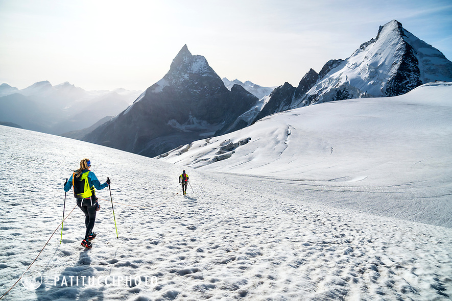 The Chamonix to Zermatt Glacier Haute Route. In late August 2017, we ran the tour in mountain running gear, running shoes, and all the necessary glacier travel and crevasse rescue gear. Descending the Stockjigletscher on the way to Zermatt on the final day with the Matterhorn and Dent d'Hérens in the background.