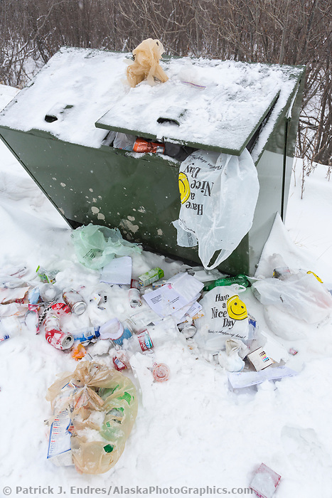 Trash overflowing from a receptacle at a rest stop along the James Dalton Highway, Arctic, Alaska.