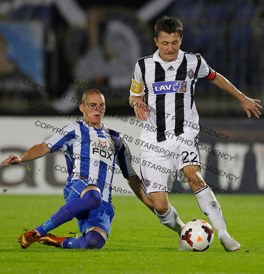 Fudbal Super liga season 2013-2014<br /> Partizan v OFK Beograd<br /> Sasa Ilic (R)<br /> Beograd, 21.09.2013.<br /> foto: Srdjan Stevanovic/Starsportphoto &copy;