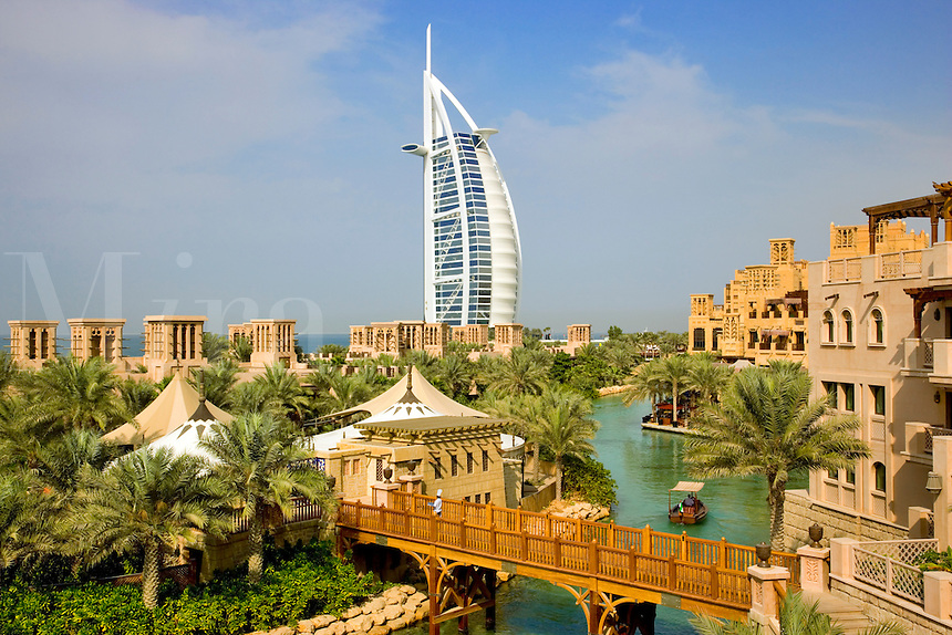 Dubai.  Burj al Arab Hotel, Al Qasr Hotel and Mina A'Salam Hotel at the Madinat Jumeirah. Chef on bridge.  .
