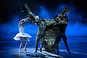 London, UK. 31.05.2016. English National Ballet presents SWAN LAKE in the round at the Royal Albert Hall. Picture shows: Alina Cojocaru (Odette), James Streeter (Rothbart), Osiel Gouneo (Prince Siegfried). Photograph © Jane Hobson.