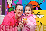 Jennifer and Hannah Reidy enjoying a cup cake at the Mad Hatters Tea party and cake sale in aid of Temple street Hospital at the Shanakill Family Resource Centre on Thursday