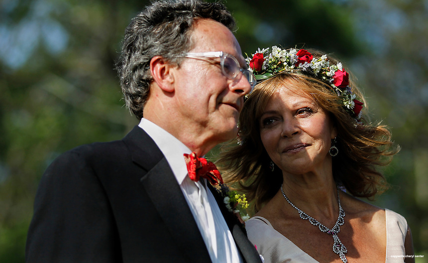 Novelist and writer Joyce Maynard looks at her soon to be husband Jim Barringer during their outdoor wedding ceremony in Harrisville, N.H., Saturday, July 6, 2013.  (Cheryl Senter for the New York Times)