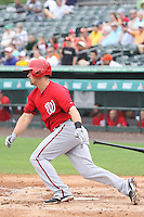Tyler Moore (12) of the Washington Nationals at bat during a Grapefruit League Spring Training game at the Roger Dean Complex on March 24, 2014 in Jupiter, Florida. Washington defeated Miami 4-1. (Stacy Jo Grant/Four Seam Images)