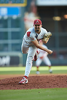 Arkansas Razorbacks starting pitcher Connor Noland (13) follows through on his delivery against the Oklahoma Sooners in game two of the 2020 Shriners Hospitals for Children College Classic at Minute Maid Park on February 28, 2020 in Houston, Texas. The Sooners defeated the Razorbacks 6-3. (Brian Westerholt/Four Seam Images)