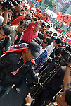 Bangkok, Jan 23: Red Shirt leader Jatuporn Prompan leads United Front for Democracy against Dictatorship (UDD) Red Shirt protestors at Ratchapraong intersection in central Bangkok as they begin their march to Democracy Monument. Red Shirt leaders vowed to rally two times each month to commemorate the military crackdowns on protestors last year. Bangkok, January 23, 2010.