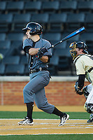 Devin Wenzel (8) of the Cincinnati Bearcats follows through on his swing against the Wake Forest Demon Deacons at Wake Forest Baseball Park on February 21, 2014 in Winston-Salem, North Carolina.  The Bearcats defeated the Demon Deacons 5-0.  (Brian Westerholt/Four Seam Images)