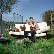 Re- Home Series. Kent, UK. 2002. Stefan and his now free-range hens at home.