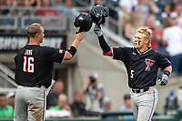 Texas Tech Red Raiders second baseman Brian Klein (5) is greeted by teammate Josh Jung (16) after hitting a home run in the sixth inning of Game 9 of the NCAA College World Series against the Florida State Seminoles on June 19, 2019 at TD Ameritrade Park in Omaha, Nebraska. Texas Tech defeated Florida State State 4-1. (Andrew Woolley/Four Seam Images)