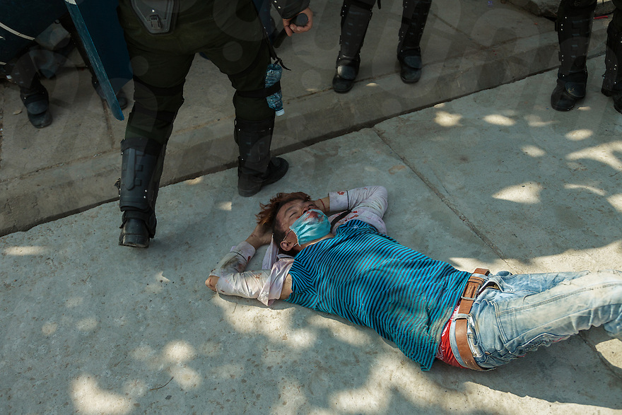 03 January, 2014 - Phnom Penh. A badly wounded protester lie unconscious on the floor after been beaten by police. © Thomas Cristofoletti / Ruom 2014