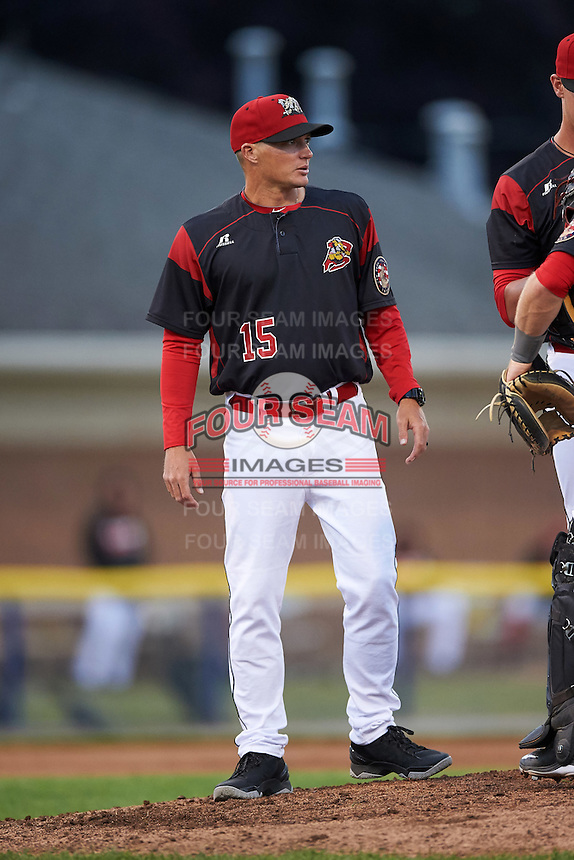 Batavia Muckdogs pitching coach Chad Rhoades (15) turns towards the dugout after a mound visit during a game against the West Virginia Black Bears on June 28, 2016 at Dwyer Stadium in Batavia, New York.  Batavia defeated West Virginia 3-1.  (Mike Janes/Four Seam Images)